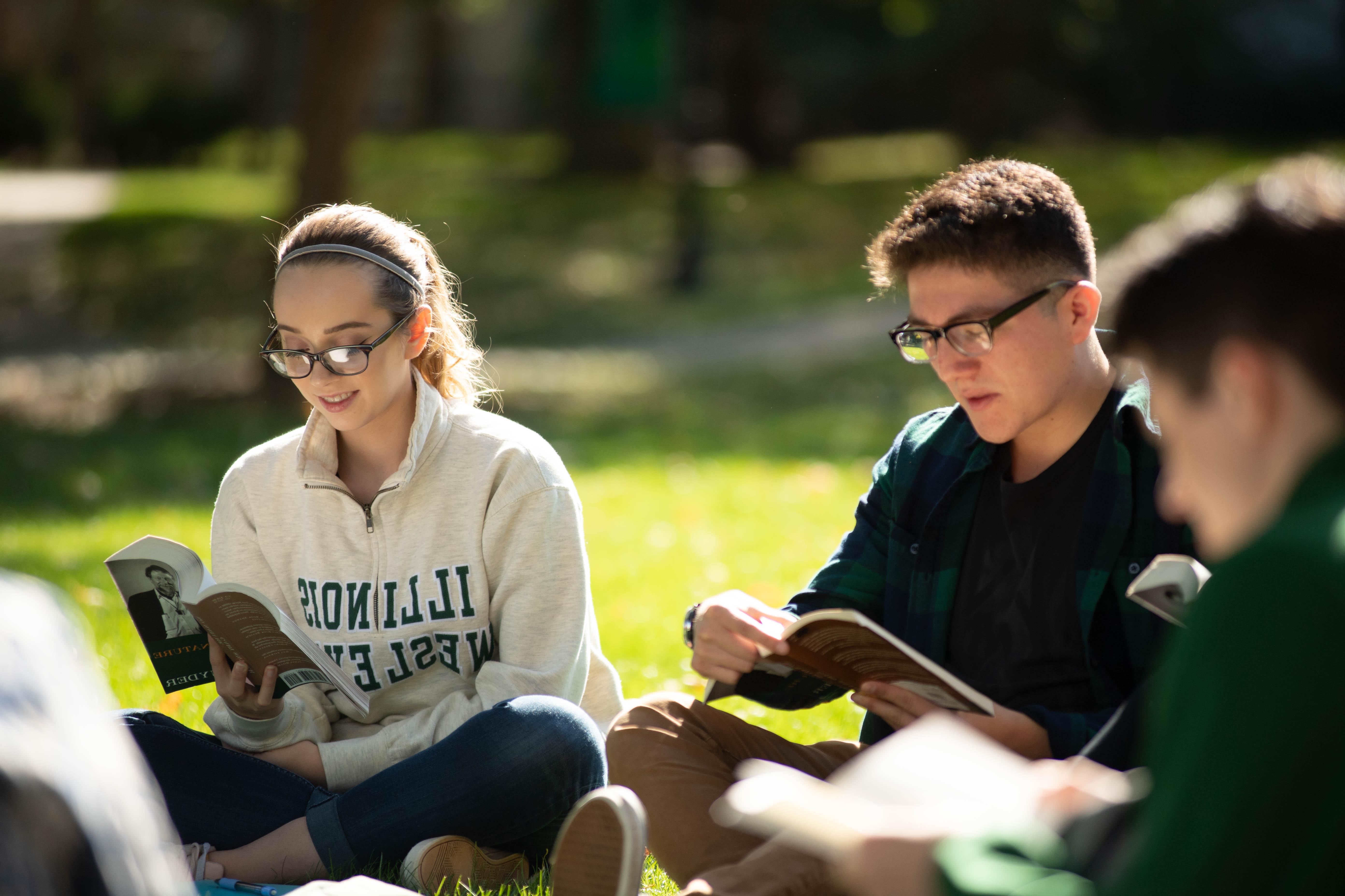 Students reading on the quad.